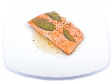 Salmon steak grilled with basil